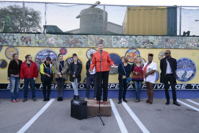 City Councillor Janet Davis is joined by the group of artists who worked on the mosaic mural project.