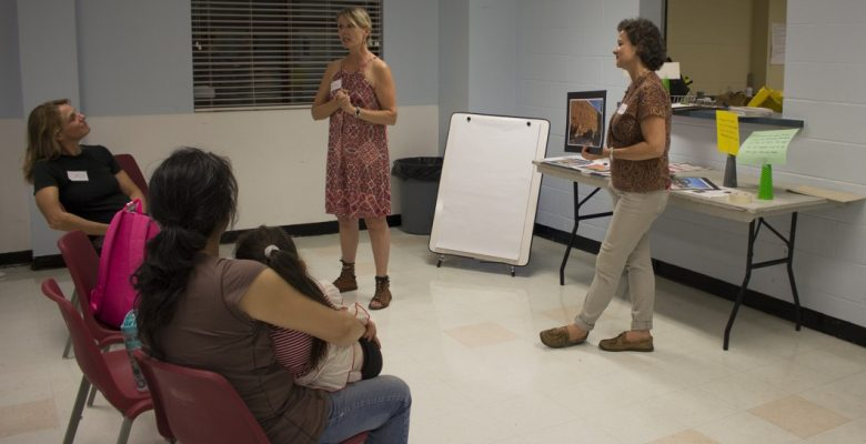 Julie Frost (left), VIBE Arts executive director and artistic director, introduces story ideas to East York community members at the consultation meeting at East York Community Centre on Pape Avenue.