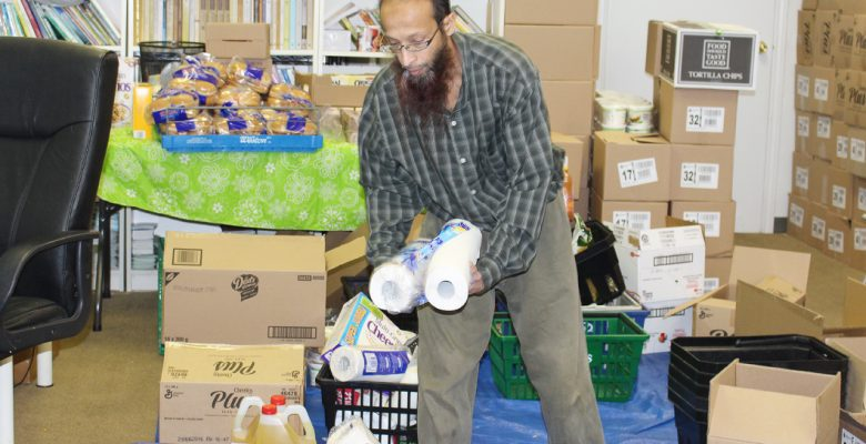 Thorncliffe food bank coordinator Zeeshan Modi sorting food and daily use items for food bank clients.