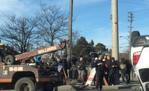 Tow truck rights car flipped upside down