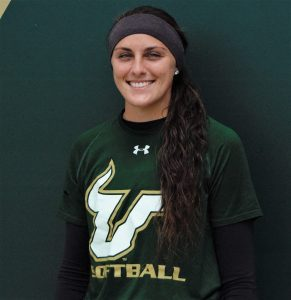 Evans poses for a head shot outside the USF softball field
