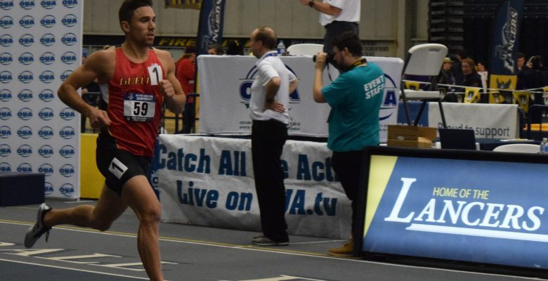 Thomas Land mid stride with his eyes on the finish line.