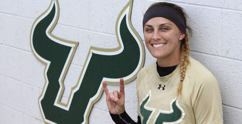 Lauren Evans posing in the dugout