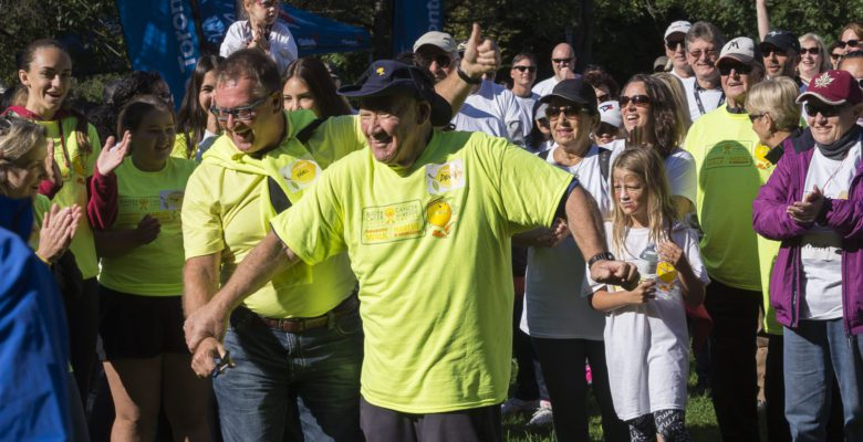 Bladder Cancer Canada co-founder David Guttman and board chair Ferg Devins cut a ribbon before hundreds of participants commence the ninth annual walk for bladder cancer awareness.