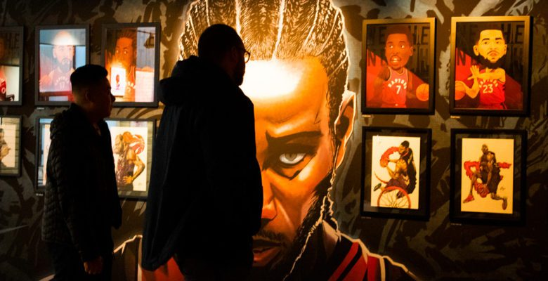 "People view ""Art of the North' exhibit which featured Toronto Raptors inspired pieces of art"