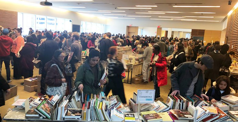 People sorting through used books