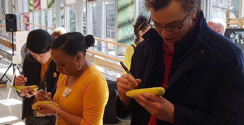 Students sign bananas